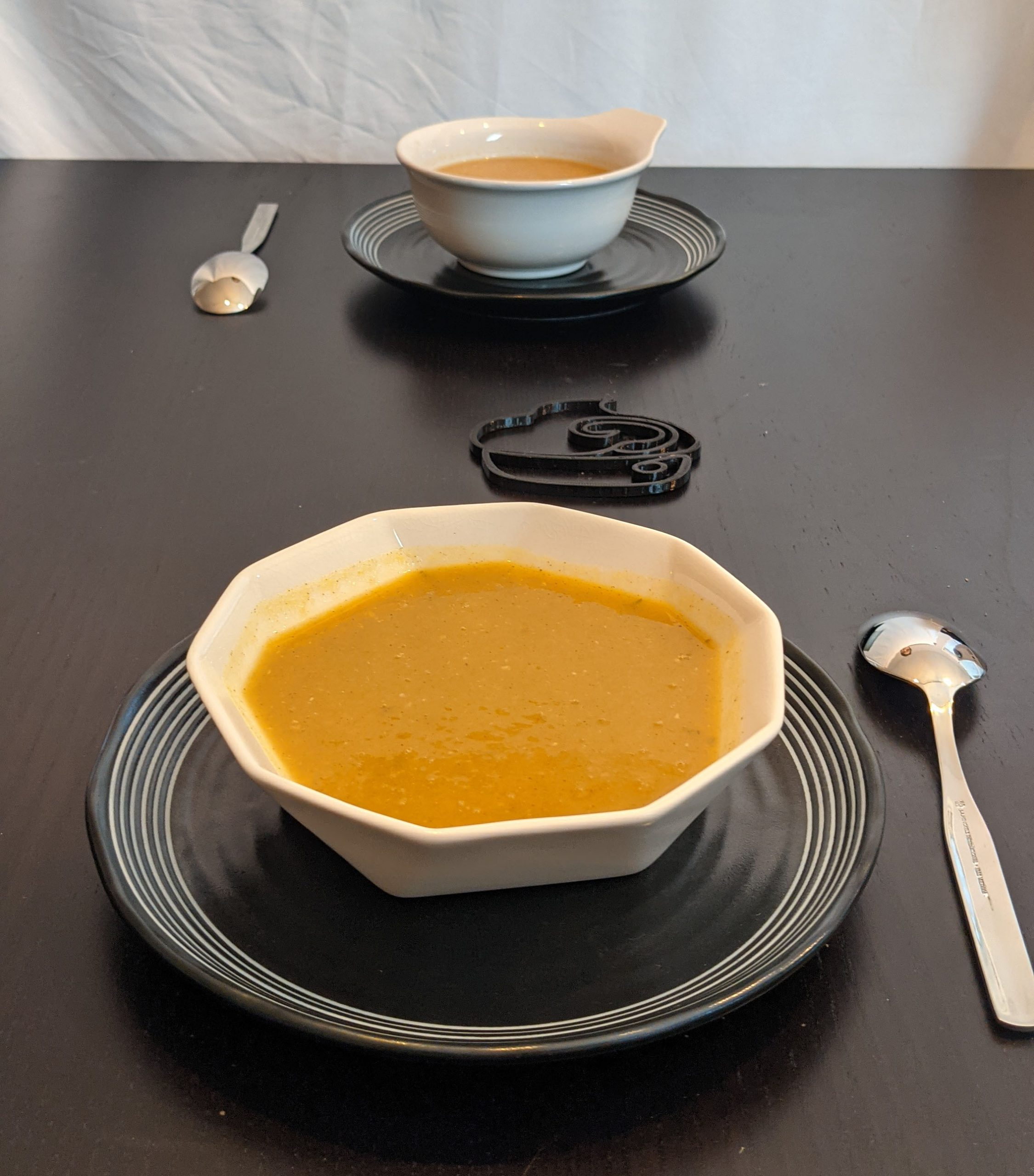 Butternut Squash Soup with another bowl on table